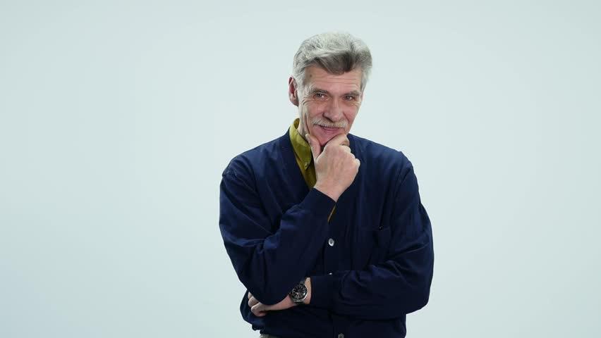Portrait of elderly man laughing on white background