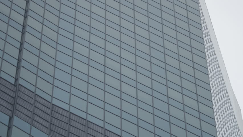 Camera tilts up against a generic high rise building, great for exterior office shots cutting into interior | Shutterstock HD Video #1008145519