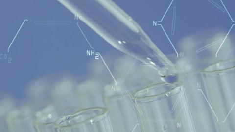 Close up of laboratory scientist working with a pipette analyzes and extract the DNA or molecules in the test tubes.on blue background with virtual interface