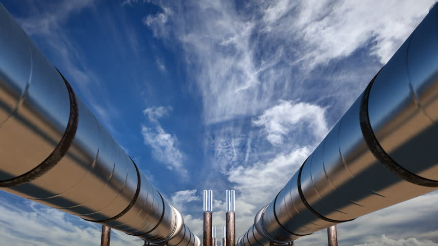 2 oil pipelines under blue sky with clouds