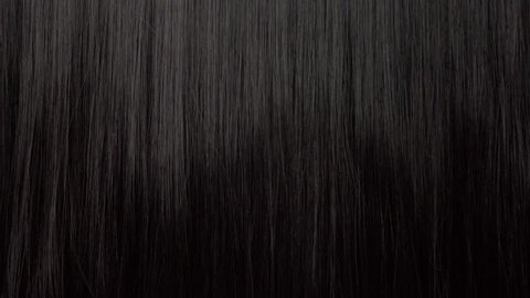Hair texture background, no person. Black shiny hair with a comb