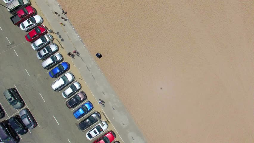 LOS ANGELES, CALIFORNIA, USA - APRIL 7, 2015: Aerial view of visitors parking and jogging trail on Santa Monica Beach in Los Angeles, California, 4K | Shutterstock HD Video #1008165919