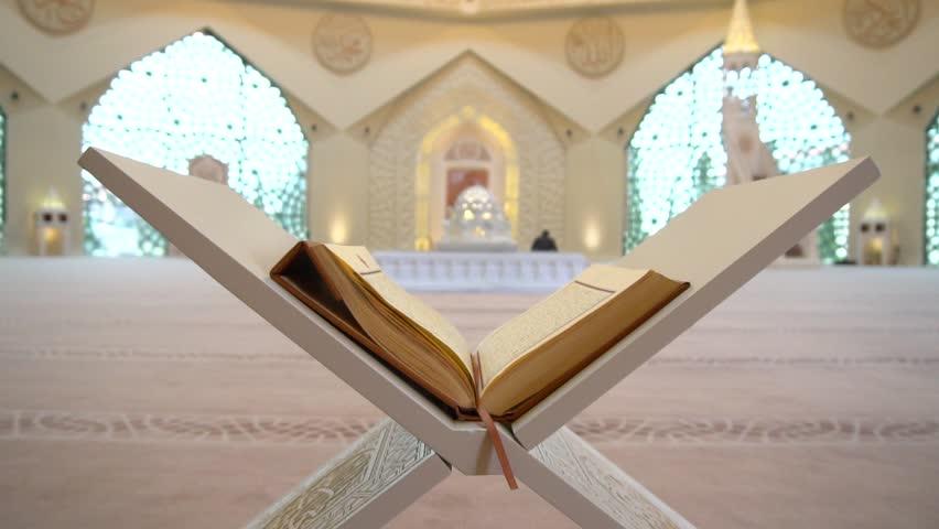 A Muslim man reads a koran or quran in an Islamic mosque | Shutterstock HD Video #1008172069