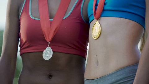 Young female prize winners celebrating victory in sports competition, career