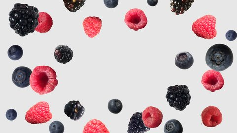 raspberries, blackberries and blueberries fly in different directions. Berry blast. berry mix. Alpha channel