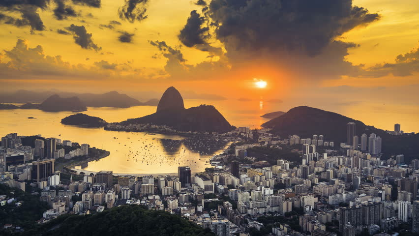 Sunrise over Sugarloaf Mountain in  Rio de Janeiro, Brazil. High angle view with reflection of the rising sun on water