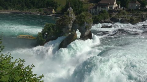 View waterfall the Rhine Falls (Rheinfalls) in Schaffhausen, Switzerland. The Rhine Falls is the largest waterfall in Europe. Summer landscape and sunny day. 4K footage, video camera format 3840x2160