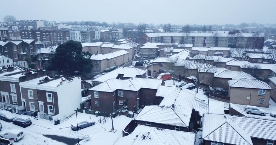 Low altitude drone flight over rooftops in South London England during a rare snow storm in March, 2018. | Shutterstock HD Video #1008265609