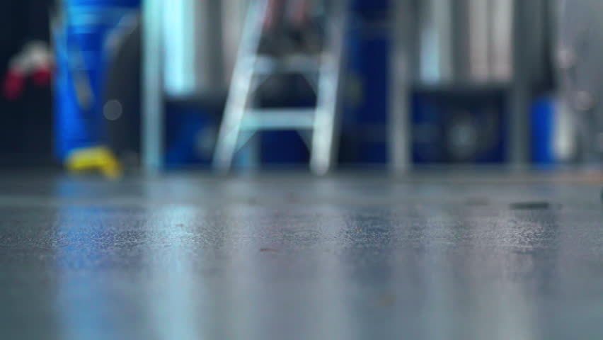 Mop on distillery floor cleaning after alcohol production