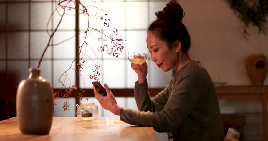 Japanese Female drinking green tea in traditional house and reading message on phone, Kyoto, Japan | Shutterstock HD Video #1008332419