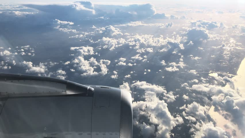 Flying over the English Channel in the morning sun #1008353869