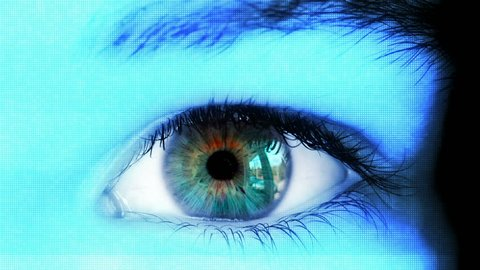 Close up of high tech futuristic eye with hud on iris