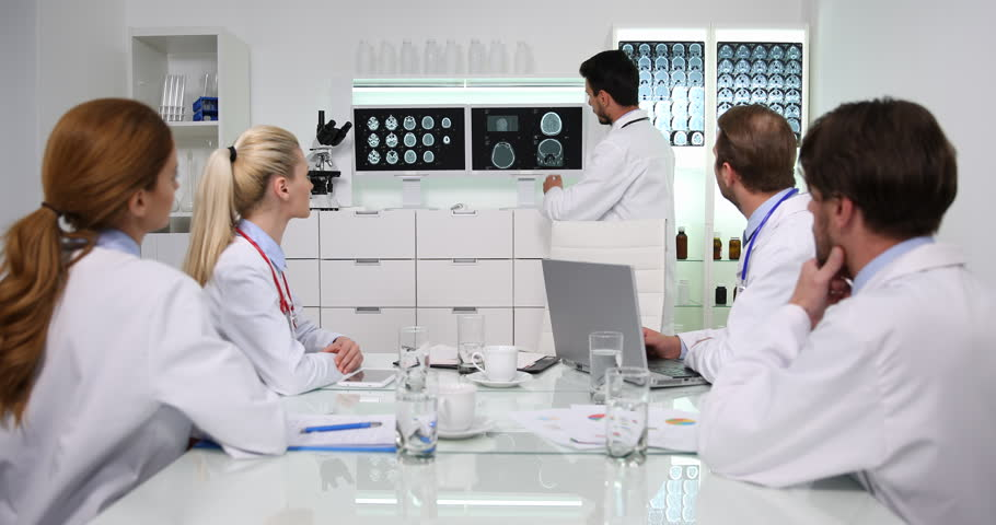 Doctor Man Talk with Medical Team in Boardroom Showing Cranial Mri on a Computer | Shutterstock HD Video #1008443989