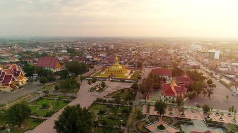 4k Video shot aerial view by drone of Wat Phra That Luang , Vientiane, Laos PDR. sunrise on Lao landmark temple.
