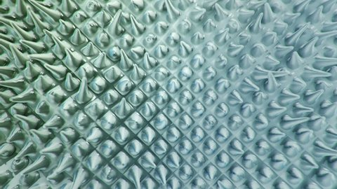 Abstract background with animation of ripples and waves in organic surface. Animation of seamless loop.