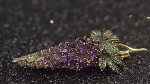 A precious barrette. Hairpin in the form of pineapple. Costume jewelry on the head.