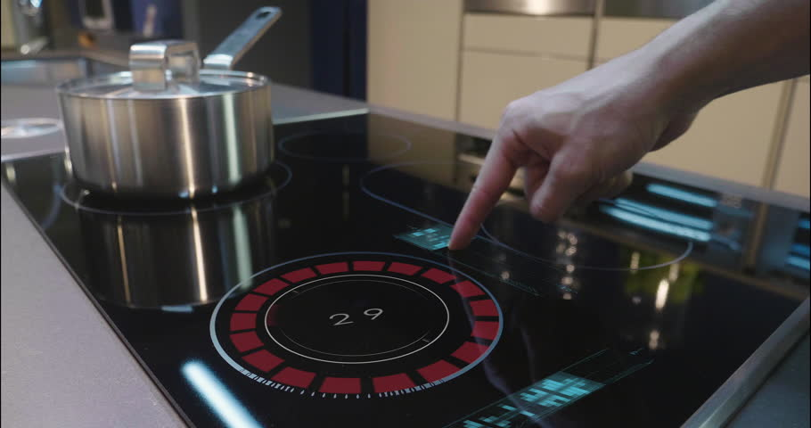 Close up of a man who cooks in his own home on a stove of the latest technology and regulates power and intensity thanks to holography. Concept of: future, technology, kitchen, augmented reality. | Shutterstock HD Video #1008523849