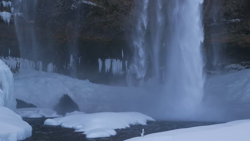 Iceland Panning Up To Reveal The Large Seljalandsfoss Waterfall In Winter 3 | Shutterstock HD Video #1008587779
