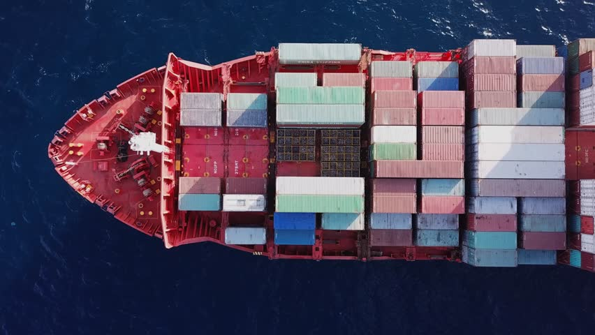 Top down aerial footage of a Large container ship at sea  #1008598699