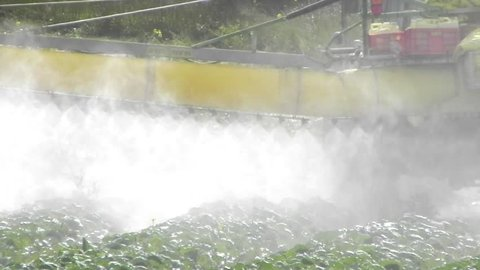 agriculture toxic tractor spraying pesticides crops fertilize organic duster