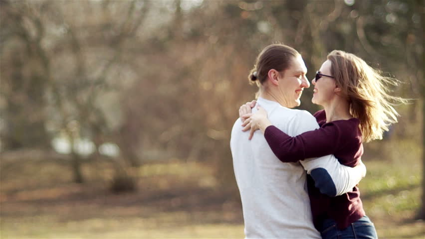 Middle-aged woman and man hugging in a spring park. Meeting after a long separation #1008653269