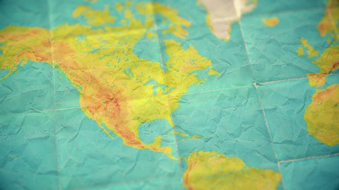 Zoom in from World Map to North America. Old well used world map with crumpled paper and distressed folds. Muted vintage colors. Blank version