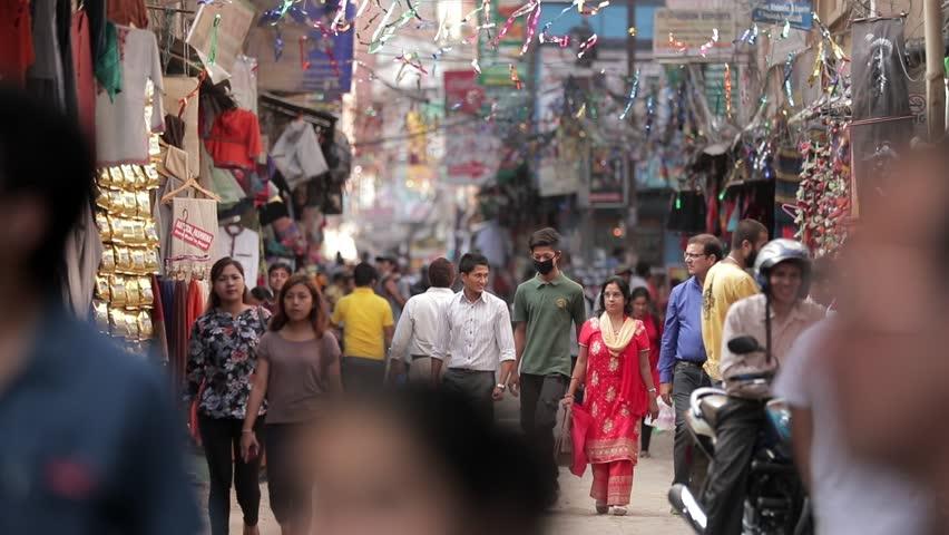 KATHMANDU, NEPAL - 29 May 2017: People of Nepal cityscape market street Durbar Square kathmandu boudhanath stupa. Crowd of people walking on busy street in Tibet