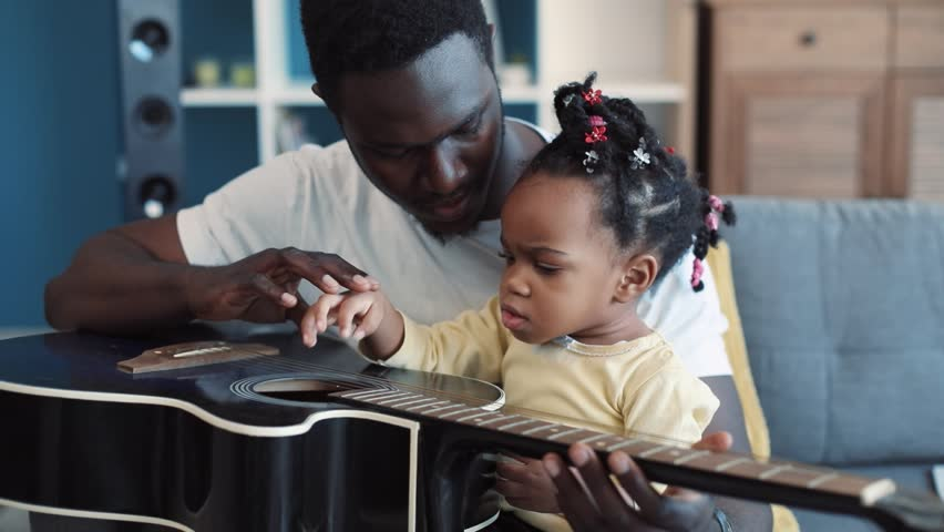 African American Young Father Holds Stock Footage Video (100% Royalty-free)  1008692989   Shutterstock