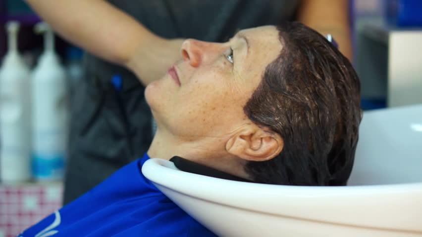 Wash off the hair dye | Shutterstock HD Video #1008712219