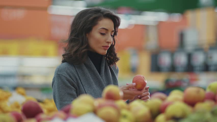 Close up young woman choosing apple at fruit vegetable supermarket marketplace | Shutterstock HD Video #1008728849