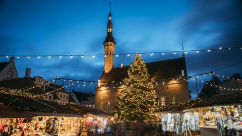 Tallinn, Estonia. Timelapse Time-lapse Of Traditional Christmas Market In Town Hall Square. Christmas Tree And Trading Houses. Famous Landmark UNESCO