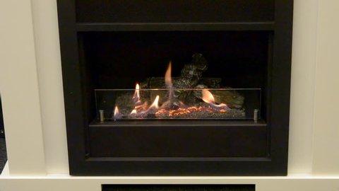 One Biofireplace burn on ethanol gas. Contemporary mount biofuel on ethanol fireplot fireplace close-up. Decorated bio fireplace. Modern smart ecological alternative technologies. Interior house