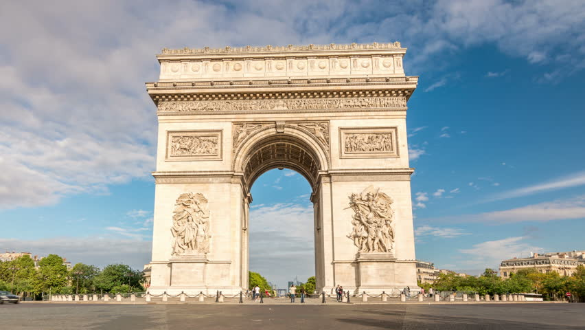 The Arc de Triomphe, one of the most famous monuments in Paris. Cars in traffic circle. Clouds move across the blue sky. Zoom out. time lapse video. | Shutterstock HD Video #1008779699