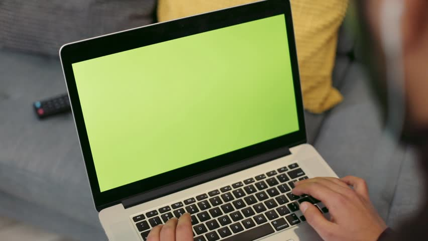 Male hands actively typing the keyboard of the laptop with green screen. Being online, gaming, texting, surfing the internet. Slow motion, camera stabilizer shot, close up view | Shutterstock HD Video #1008796199