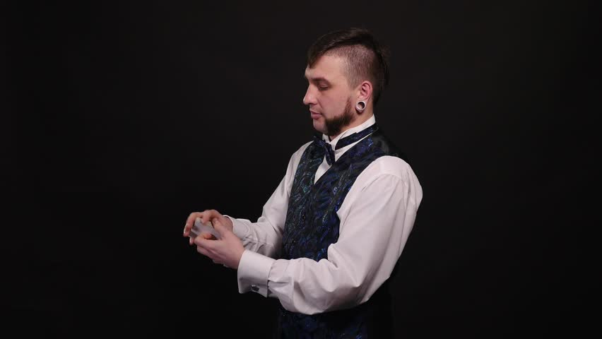Magic, card tricks, gambling, casino, poker concept - man showing trick with playing cards | Shutterstock HD Video #1008822059