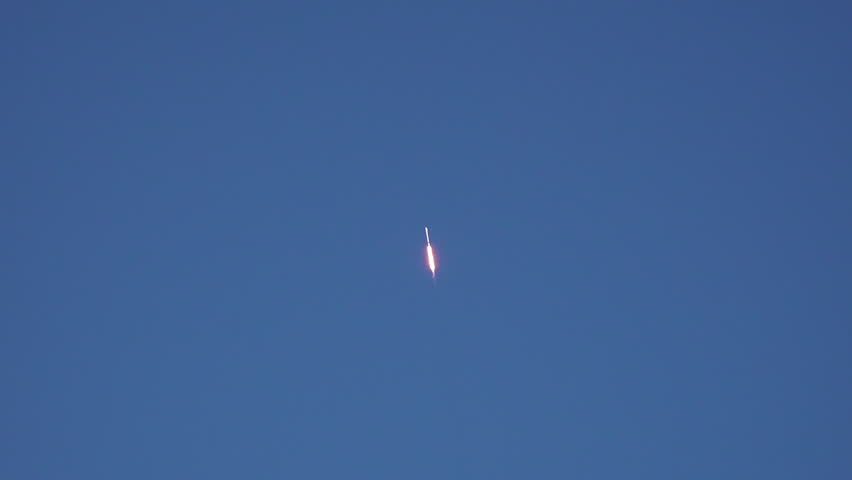 ICBM missile flying into space during daytime launch. 120 fps slow motion.