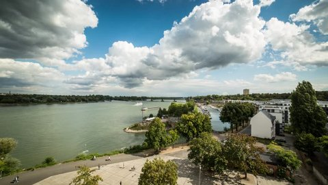 Beautiful clouds are moving at the rhine river in Mainz (time-lapse at the harbor)