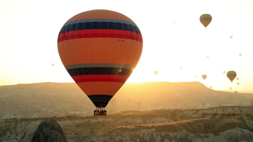 The great tourist attraction of Cappadocia - balloon flight. Cappadocia is known around the world as one of the best places to fly with hot air balloons. Goreme, Cappadocia, Turkey.  | Shutterstock HD Video #1008908609