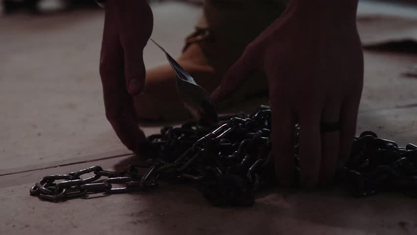 Chains falling to ground slow motion  | Shutterstock HD Video #1008913019