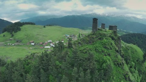 Omalo Village and watchtowers in Caucasus mountains epic flight hills and Georgian valley beauty nature georgia animals waterwall drone 4k