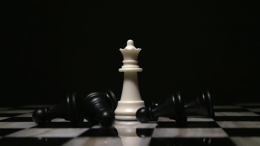 White queen piece surrounded by fallen black pawns | Shutterstock HD Video #1008924719