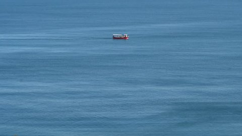A fishing boat trawling for shrimp in the early evening light