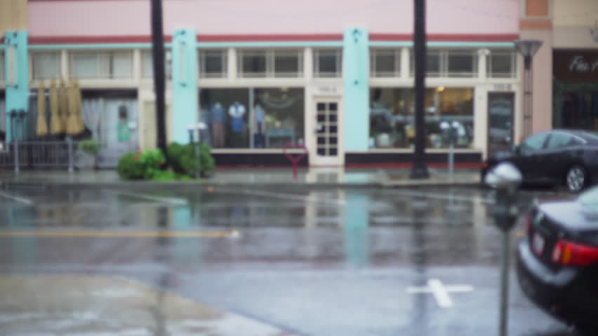 Rainy and wet city street with parking meters and parked cars for green screen or chroma key. Out of focus or defocused shot for compositing or keying. | Shutterstock HD Video #1008930149