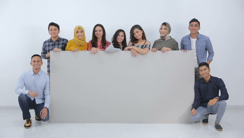 Group of young people holding blank white black board | Shutterstock HD Video #1008969059