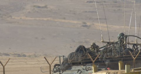 Israeli Army personal carrier on border Idf Army personal carrier in training, Negev desert, Israel