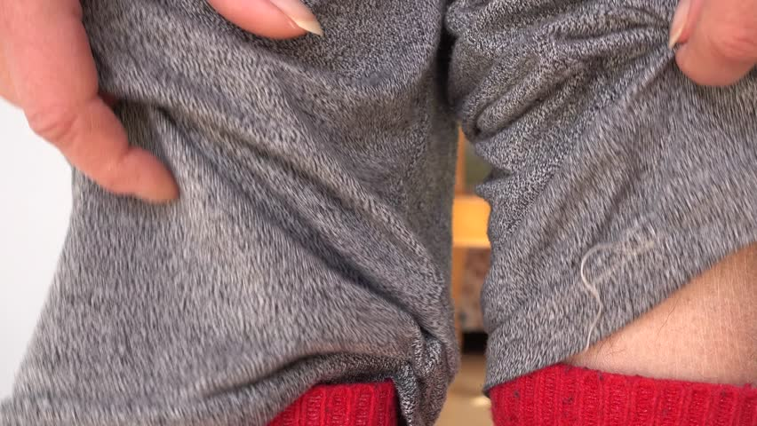 4K Lifting pant leg and revealing hairy ankle, extreme close up  | Shutterstock HD Video #1008997289