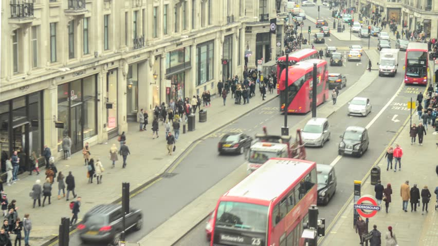 LONDON- MARCH, 2018: Aerial view time lapse of London's Regent Street traffic and busy crowds of shoppers from Oxford Circus