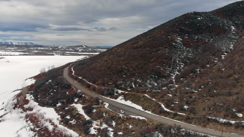 Aerial footage from a drone flying ashore over a frozen lake in Colorado. Filmed on the Grand Mesa in Western Colorado.