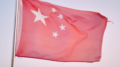 Chinese red flag flutters in wind