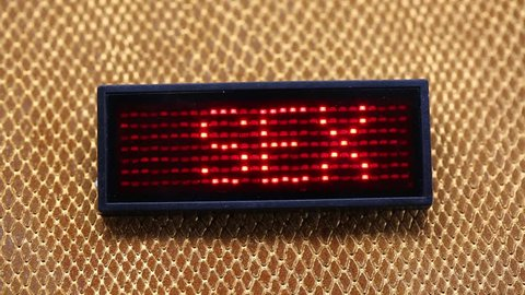 sliding text SEX flashing made with red LEDs